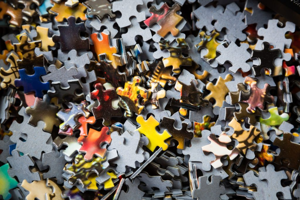 A bunch of puzzle pieces for an article on how to create your own puzzle