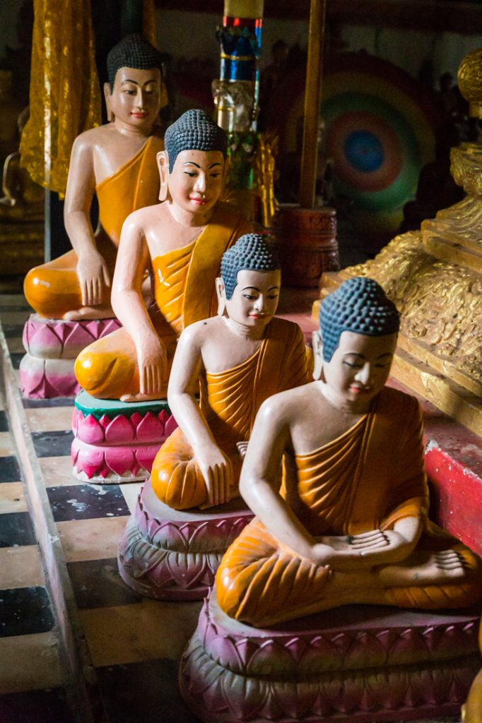 Line of buddha sculptures in Cambodia