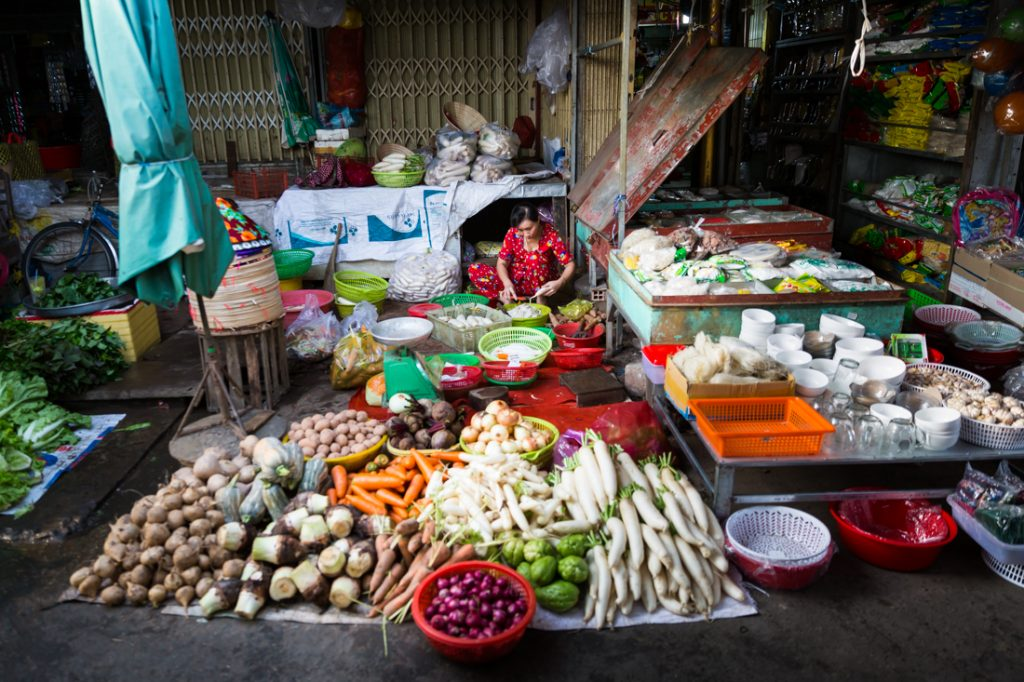 Woman selling vegetables in a Vietnamese market