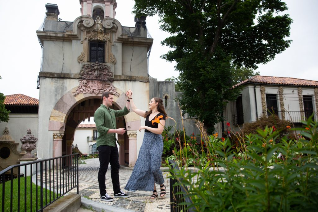 Couple dancing in front of gate at the Vanderbilt Museum