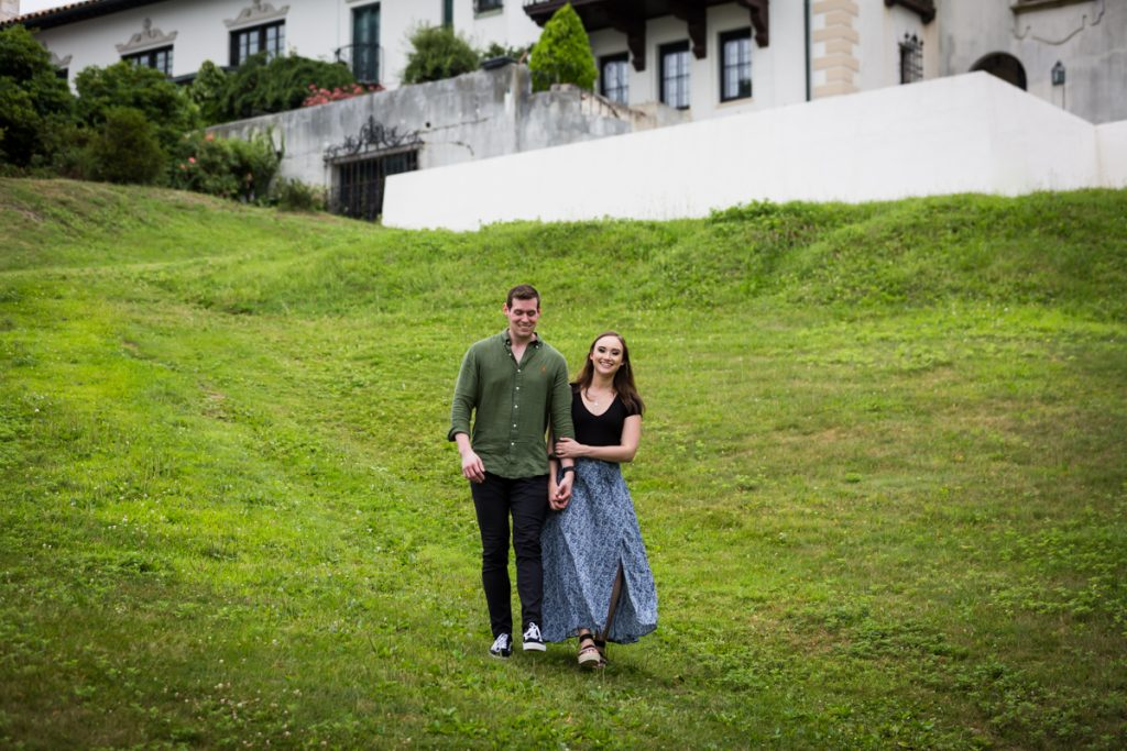Couple walking in grass at the Vanderbilt Museum
