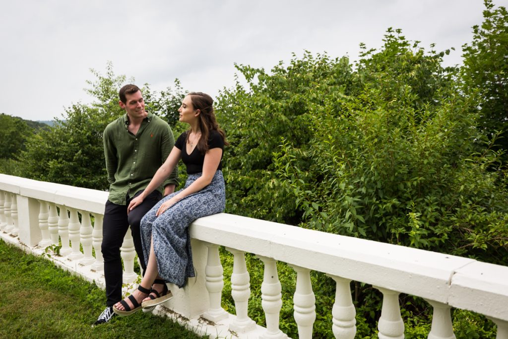 Couple sitting on stone railing at the Vanderbilt Museum