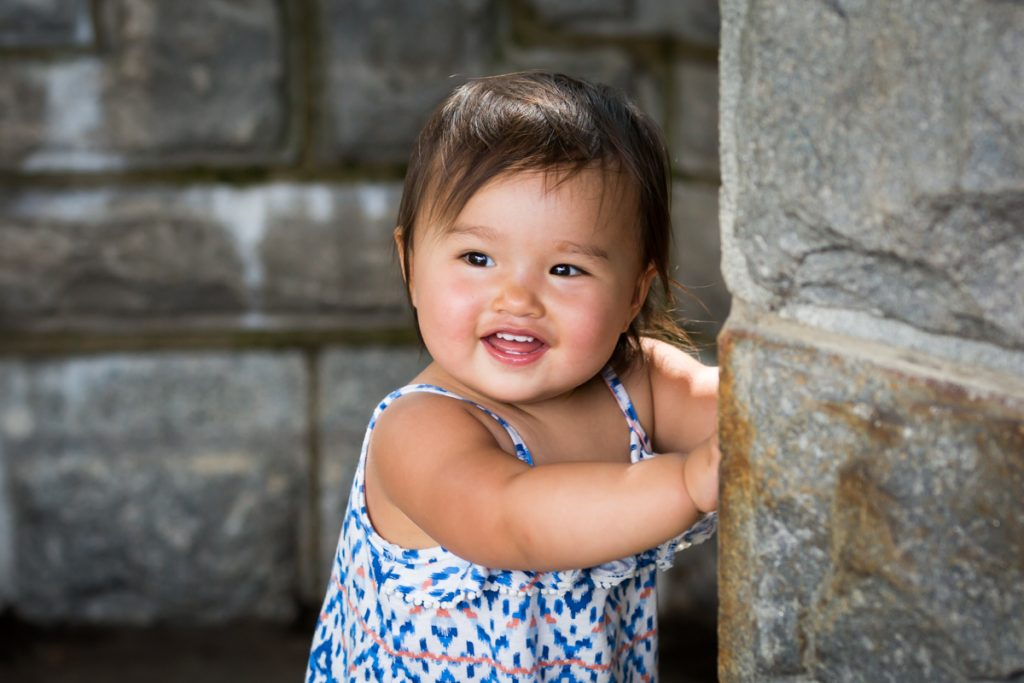 Little girl smiling during Belvedere Castle family portrait in Central Park