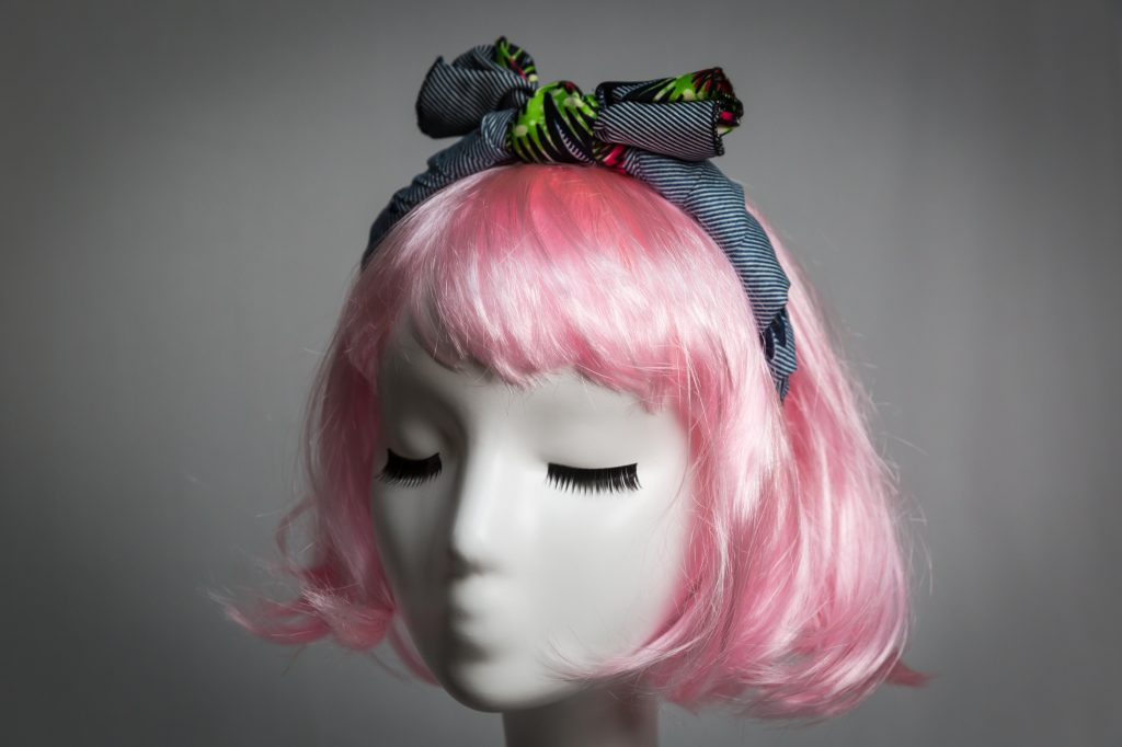Pink haired mannequin wearing African wax cloth fabric headband