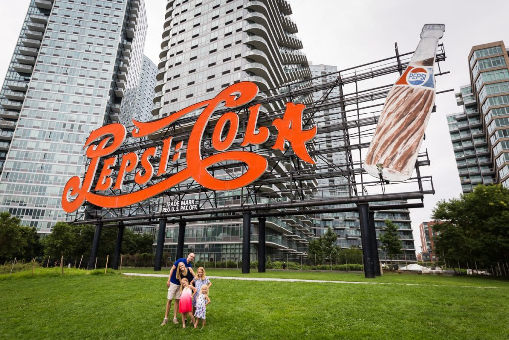 Family in front of Pepsi Cola sign during a Gantry Plaza family portrait session