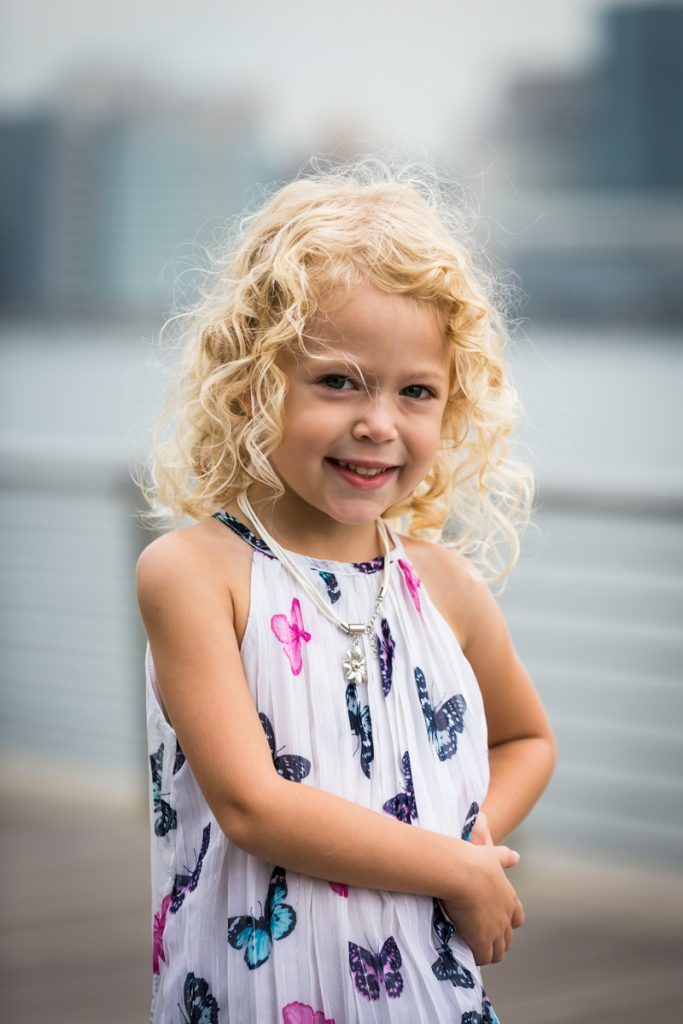 Little girl with blond hair during a Gantry Plaza family portrait session