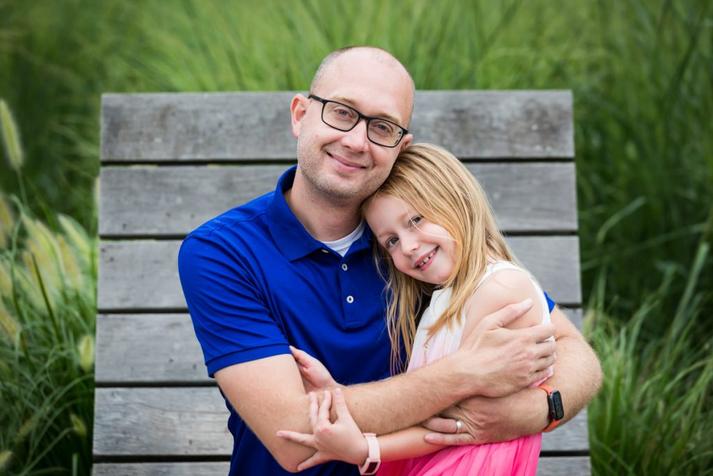 Blond haired girl hugging bald father