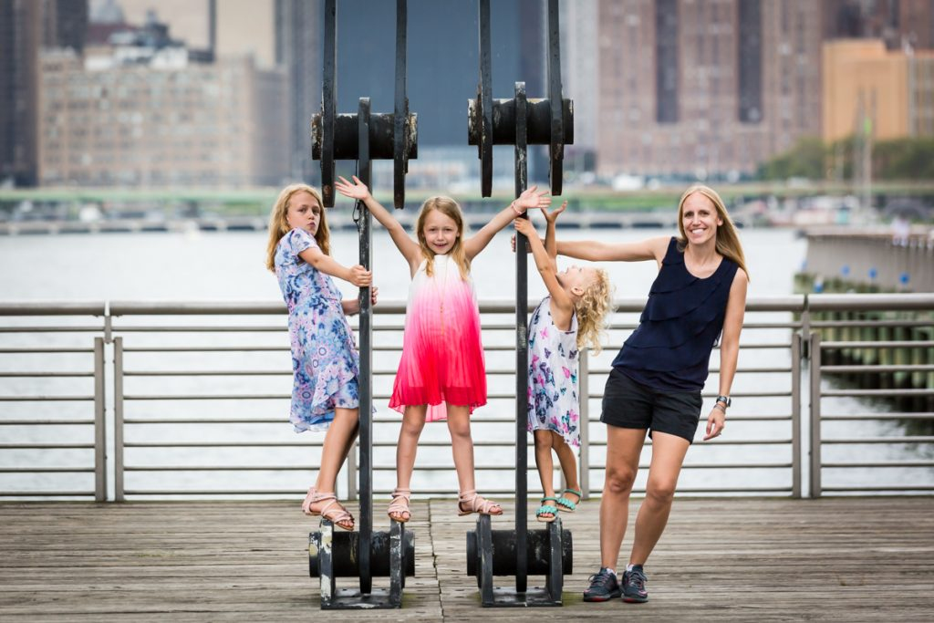 Mother and three daughters playing on gantry at Gantry Plaza State Park