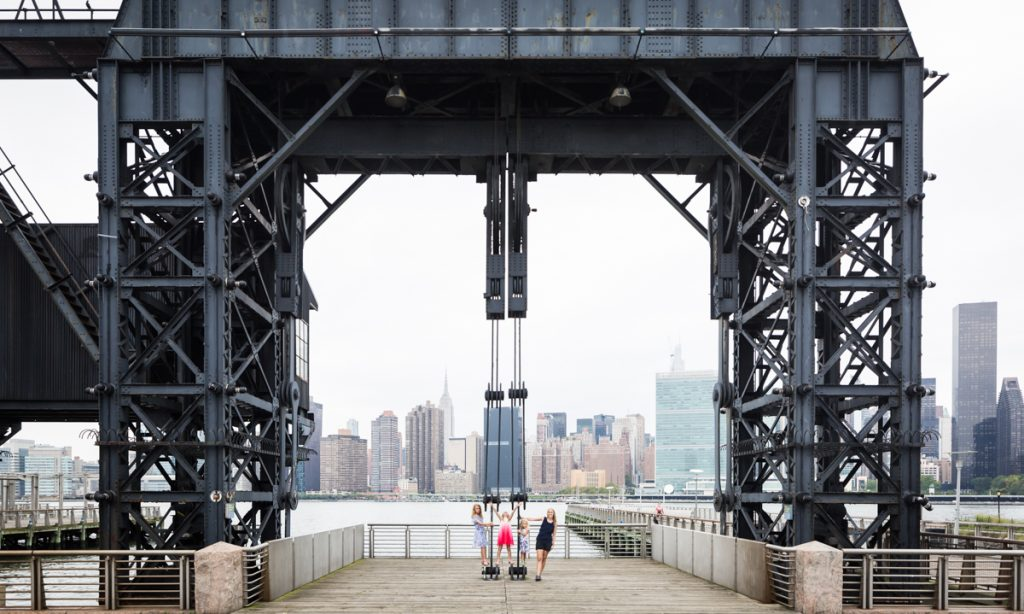 Family playing under gantry during a Gantry Plaza family portrait session