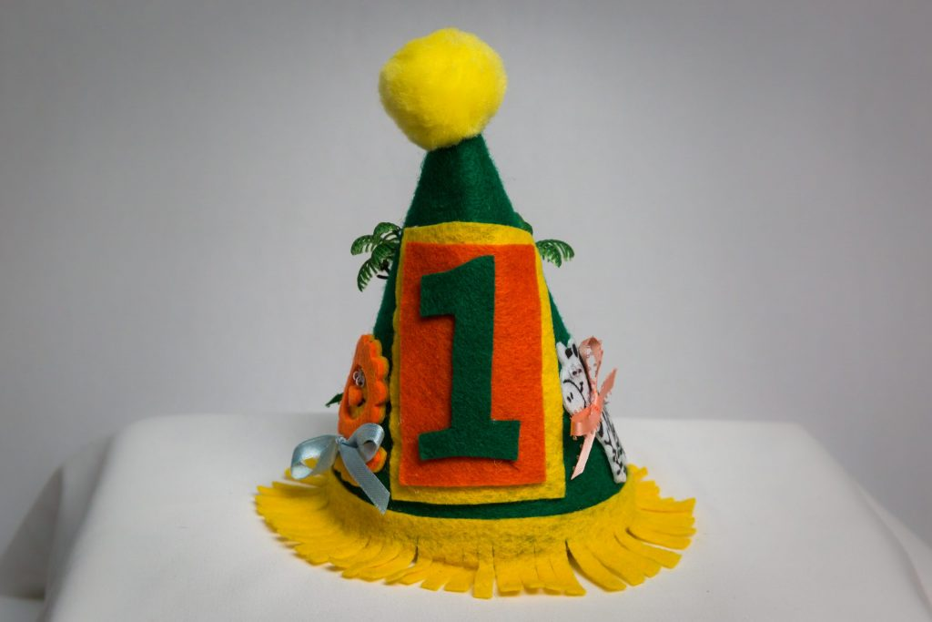 Green and yellow first birthday party hat