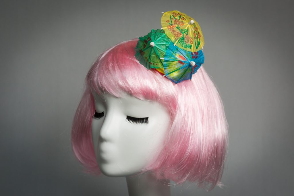Pink haired mannequin wearing cocktail umbrella fascinator by Chapeau A Go Go boutique