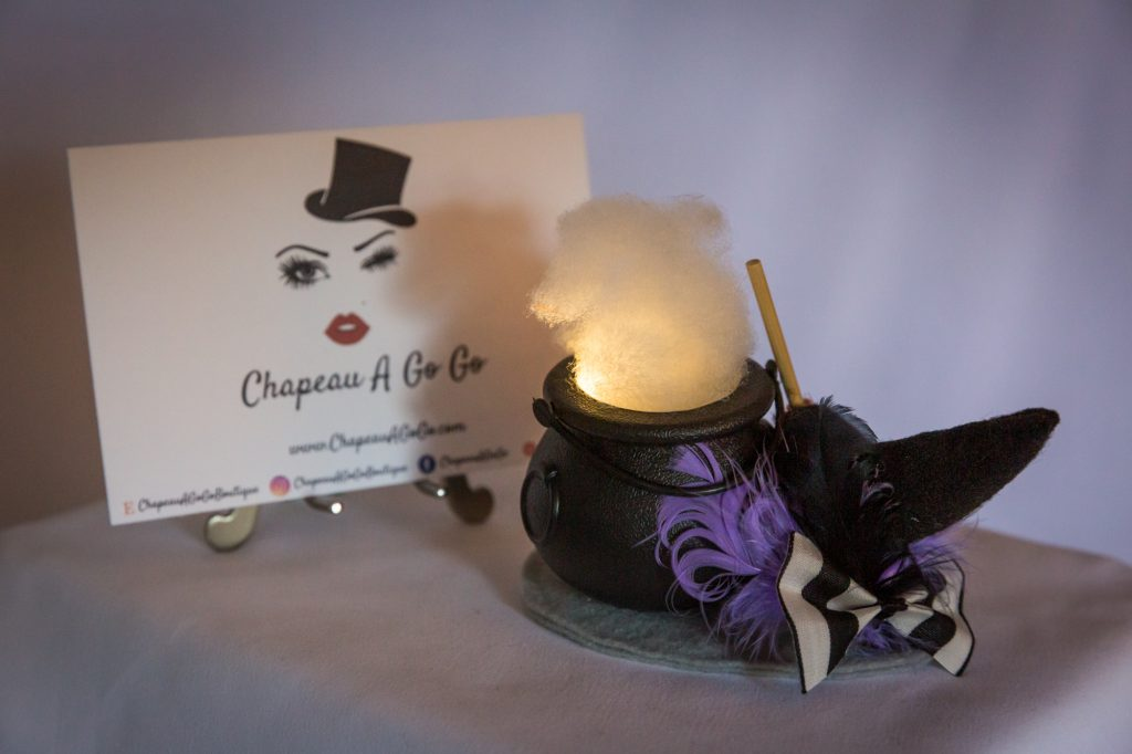 Black and purple witch cauldron fascinator that lights up