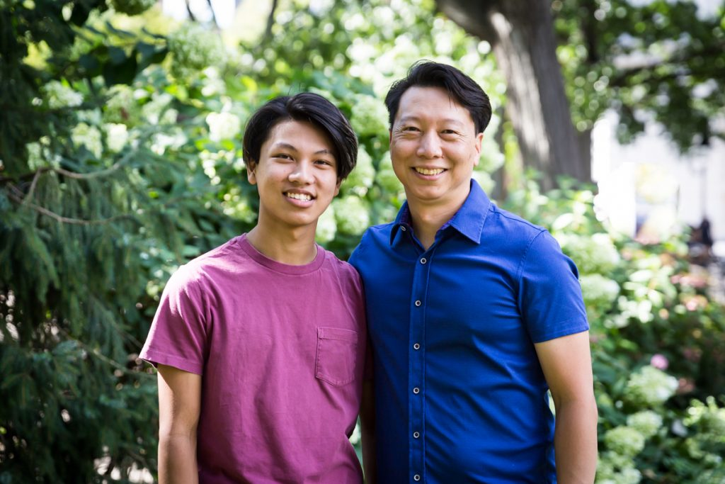 Young man and father during Washington Square Park family portrait