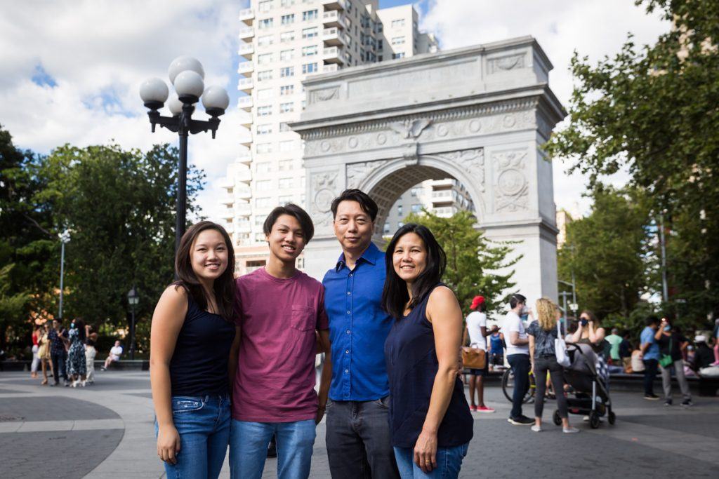 Family standing in front of Washington Square Park arch