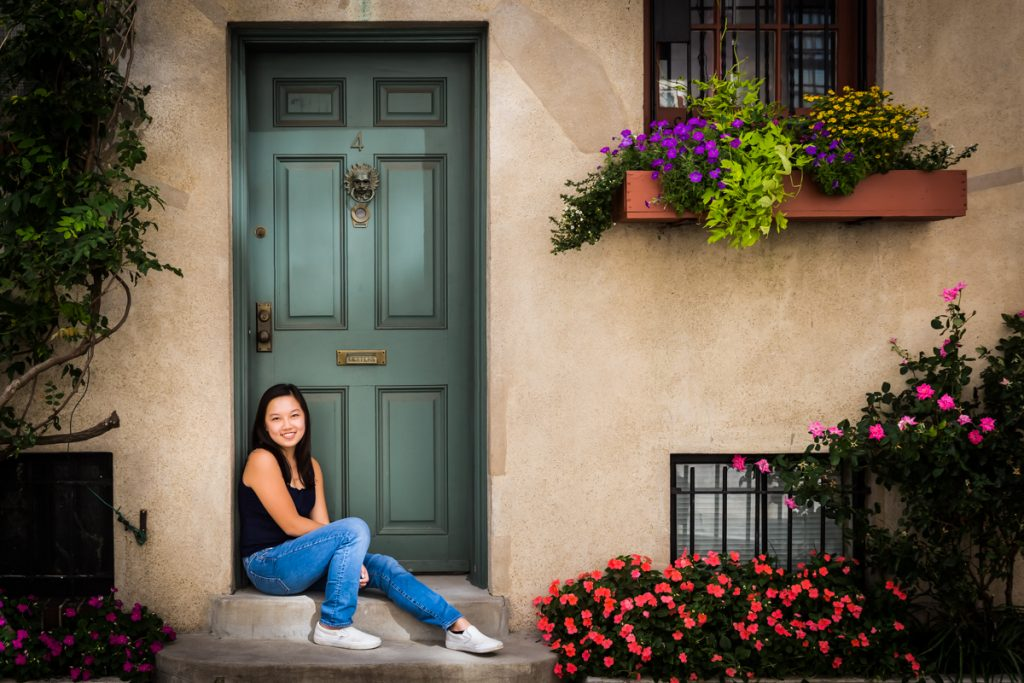 Teenager sitting in doorway for an article on photo tips for older children