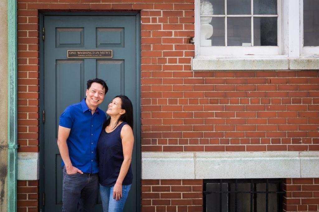 Couple in doorway against brick wall in Washington Mews