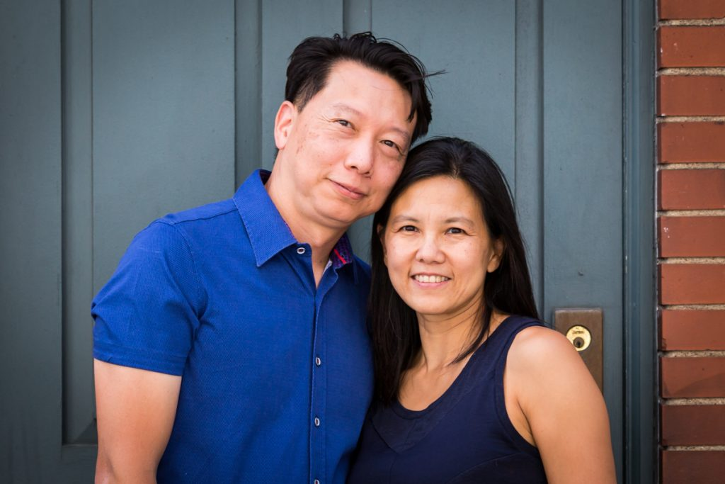 Couple in doorway during Washington Square Park family portrait