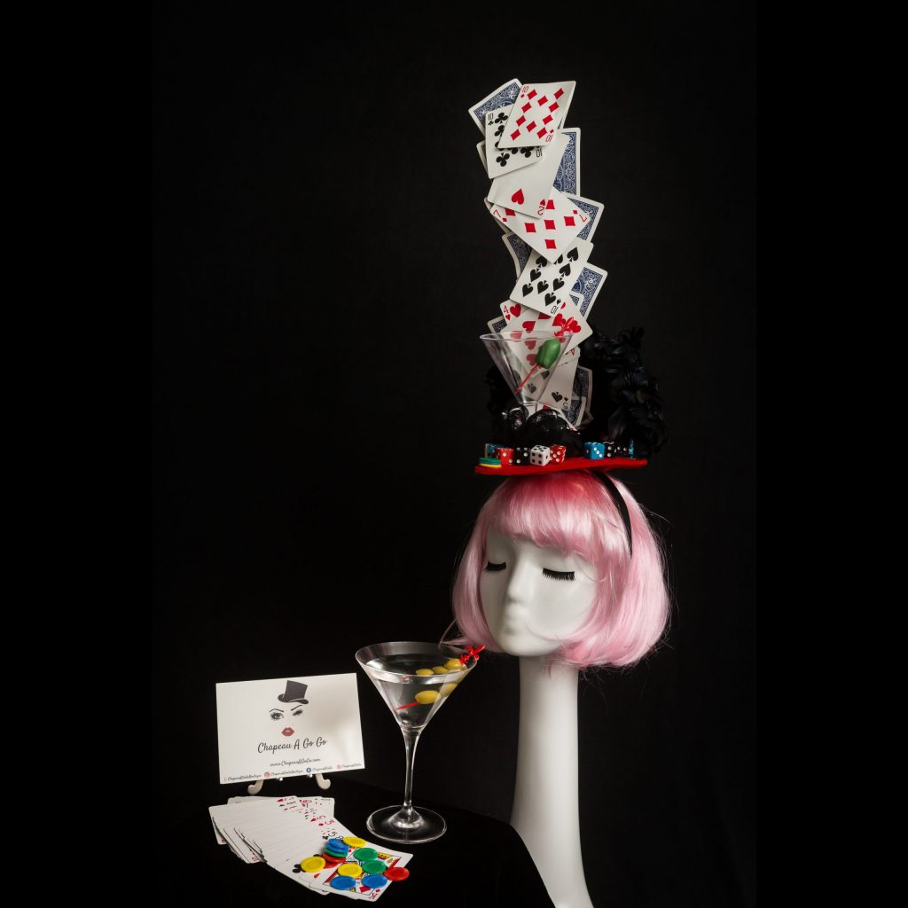 Pink haired mannequin wearing playing card Las Vegas headband by Chapeau A Go Go