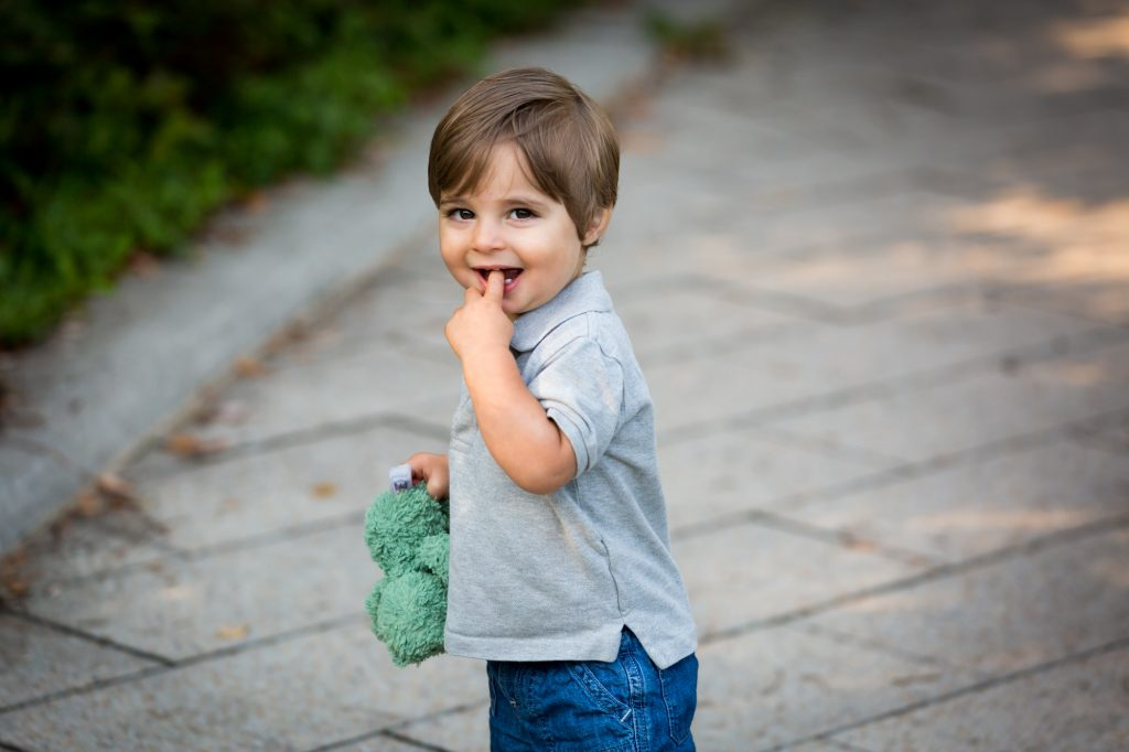 Little boy with finger in mouth in Hudson River Park