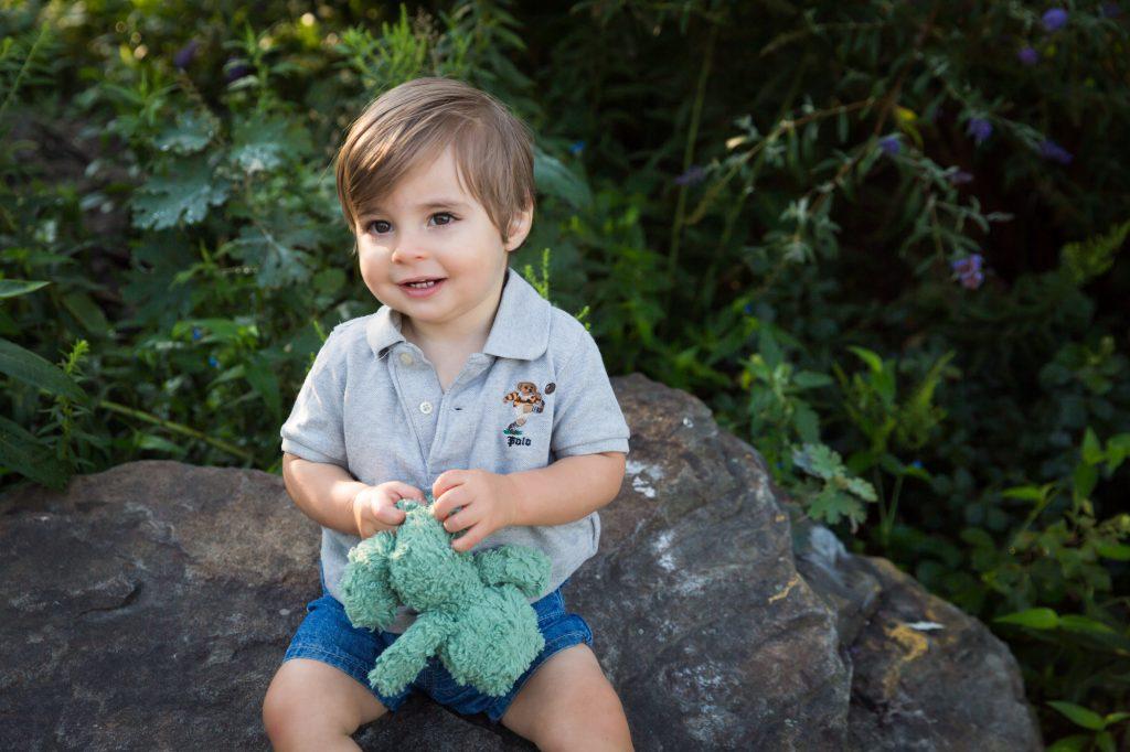 Little boy sitting on rock in Hudson River Park