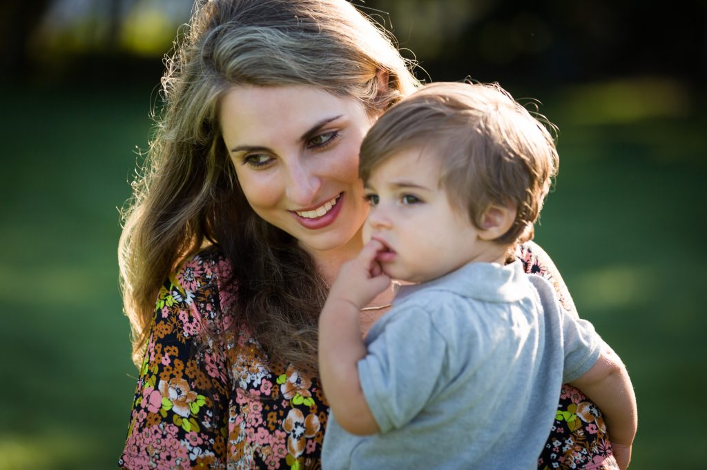 Mother holding little boy in Hudson River Park