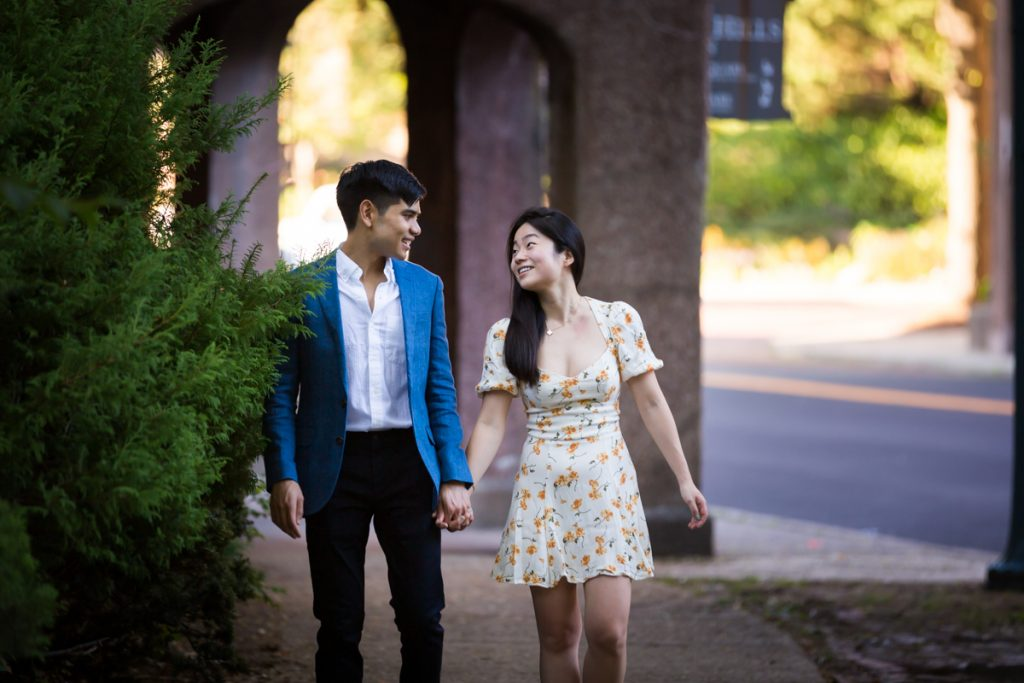 Couple walking hand in hand on Greenway Terrace during Forest Hills engagement shoot