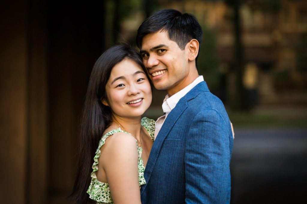 Couple in dark archway during Forest Hills engagement session