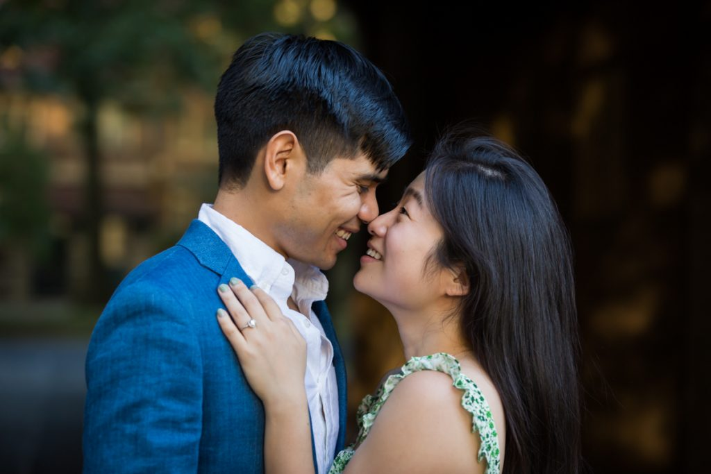 Couple looking at each other during Forest Hills engagement shoot