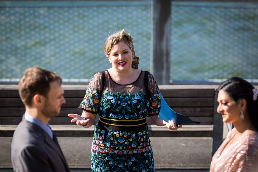 Female officiant during Brooklyn Bridge Park wedding ceremony