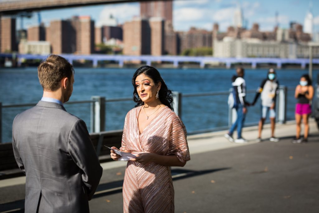 Bride saying vows to groom during Brooklyn Bridge Park wedding ceremony