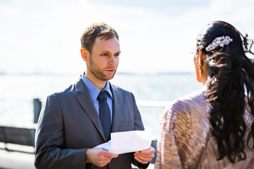 Groom saying vows to bride during Brooklyn Bridge Park wedding ceremony
