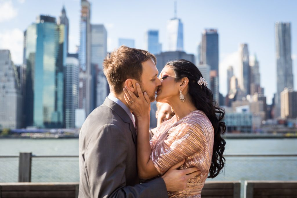 Bride and groom kissing after ceremony for an article on how to get married in Brooklyn Bridge Park