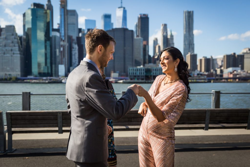 Bride and groom fist bumping for an article on how to get married in Brooklyn Bridge Park