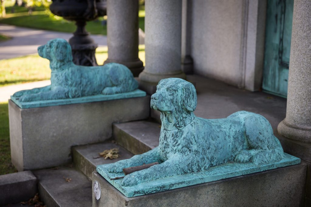 Dog statues in front of mausoleum at Green-Wood Cemetery