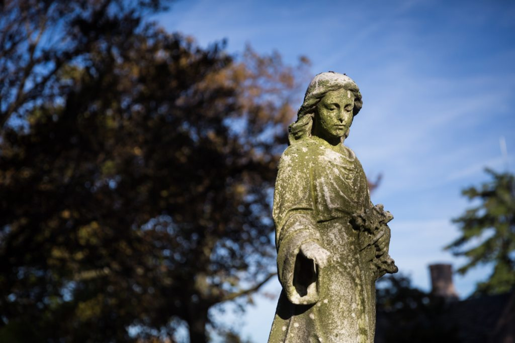 Grave statue with arm outstretched at Green-Wood Cemetery