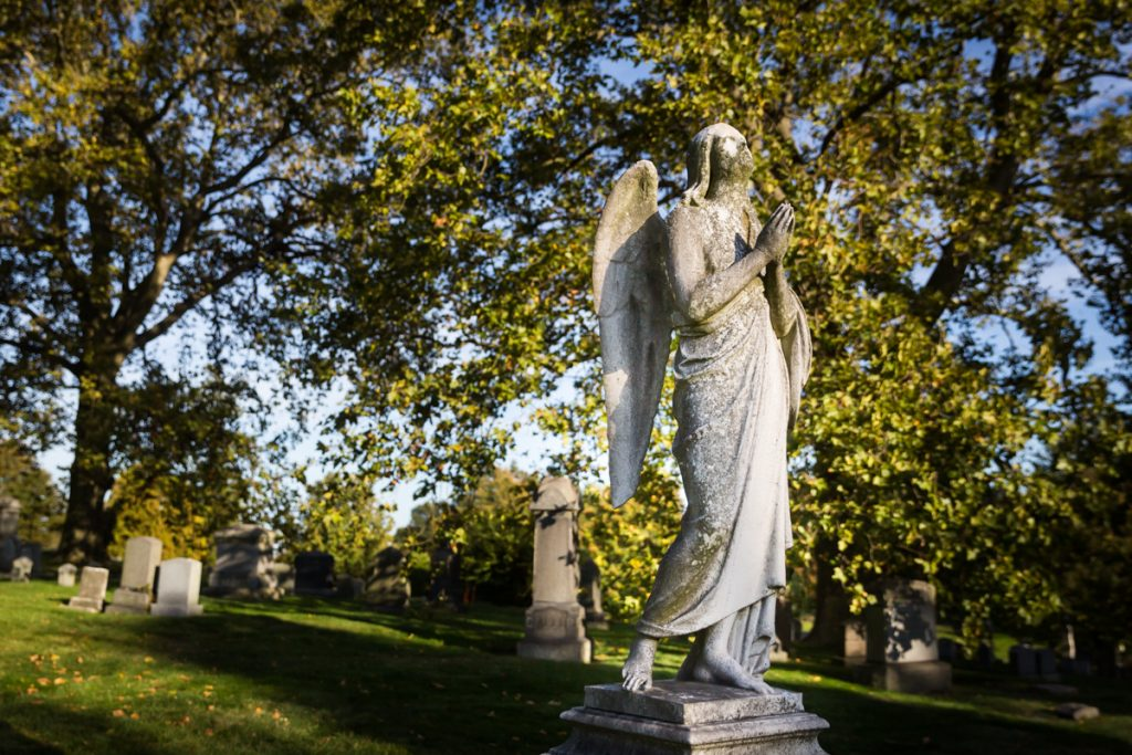 Praying angel statue for an article on visiting Green-Wood Cemetery
