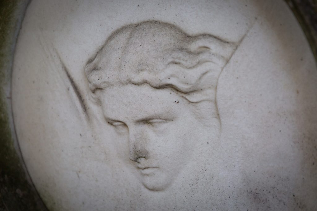 Face of woman on grave at Green-Wood Cemetery