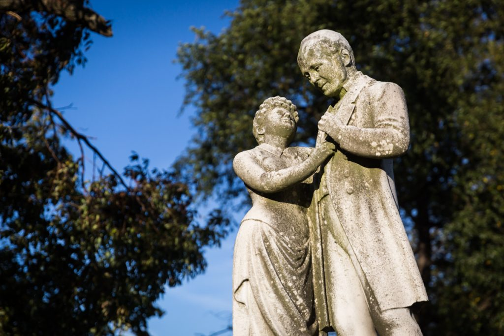 Statue of couple dancing at Green-Wood Cemetery