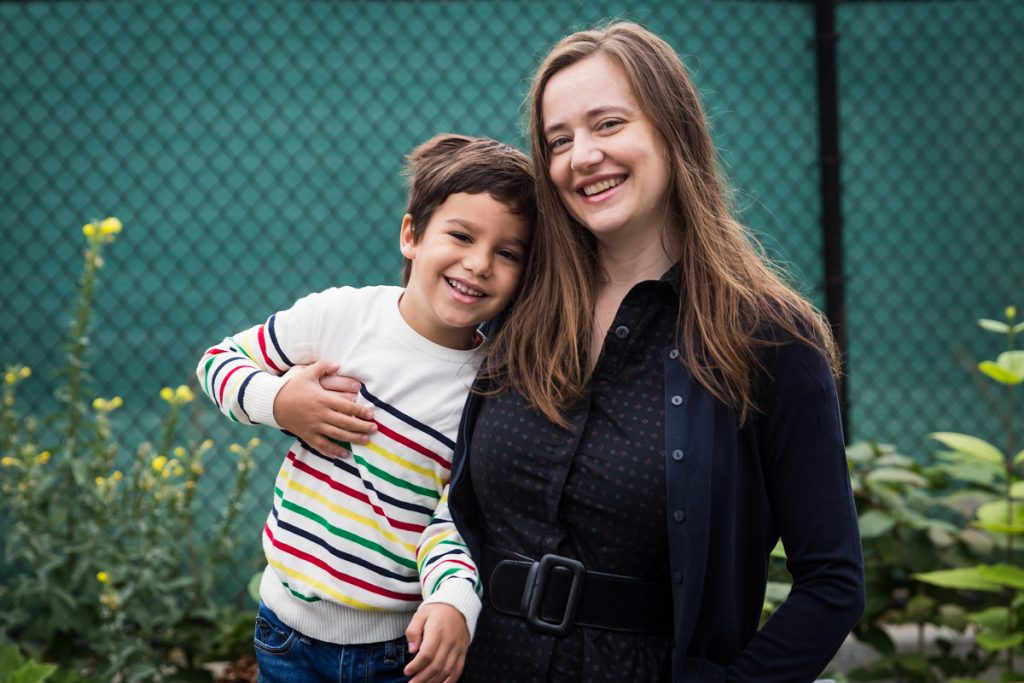 Mom and son in front of fence during a Gowanus family portrait session