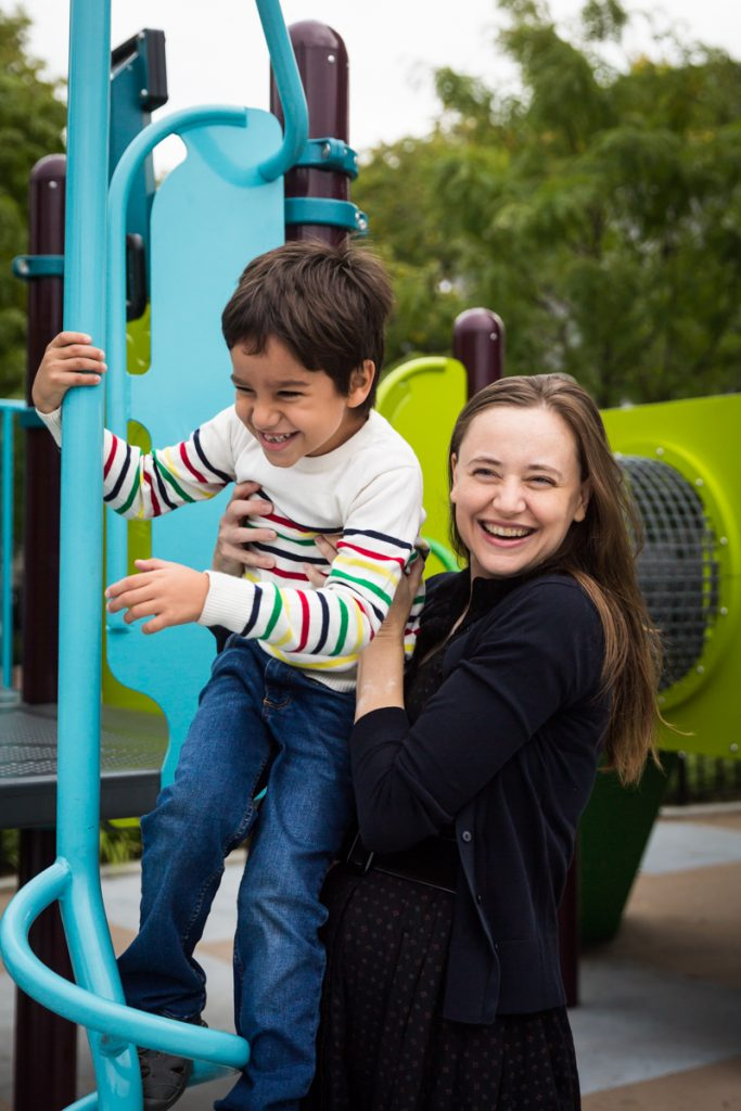 Mother and son playing on jungle gym during a Gowanus family portrait session