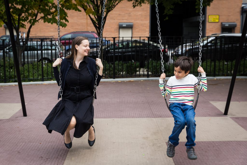 Mother and son on swings during a Gowanus family portrait session