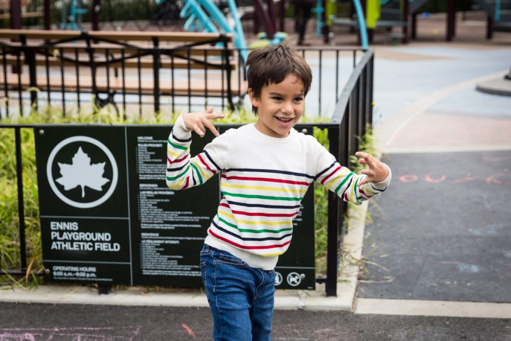 Young boy dancing at an Ennis Playground family portrait session