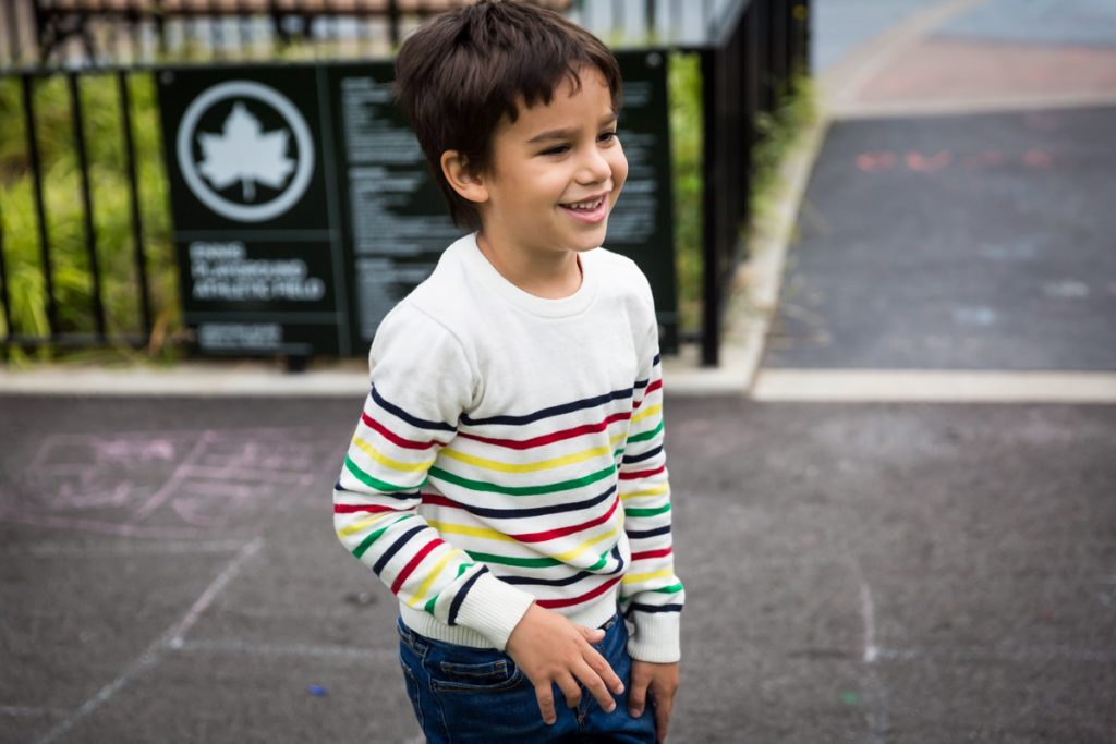 Boy wearing colored strip shirt at an Ennis Playground family portrait session