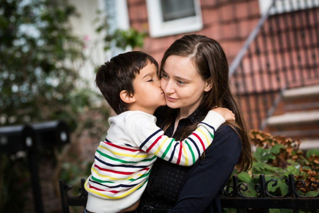 Boy kissing mother on the cheek