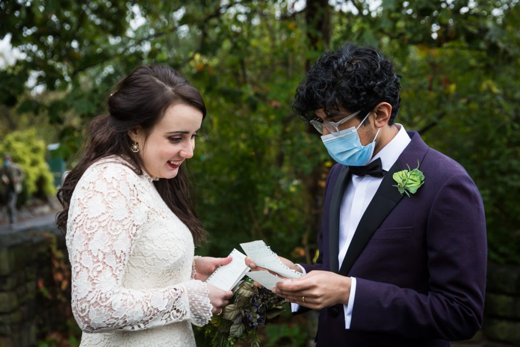 Couple checking personal vow notes before Fort Tryon Park wedding ceremony