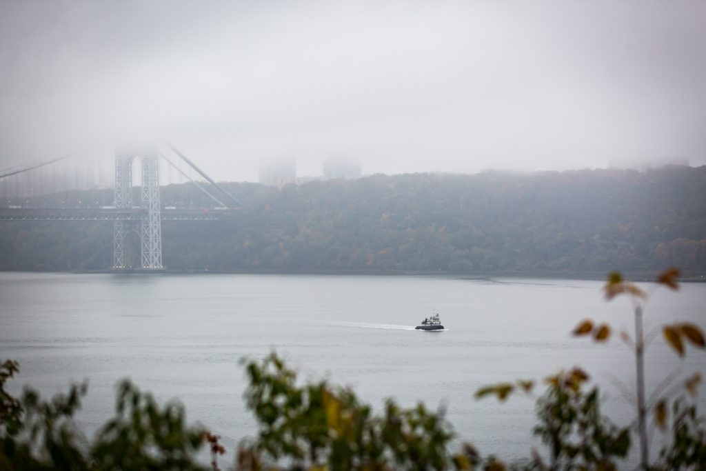View of George Washington bridge and boat in Hudson River