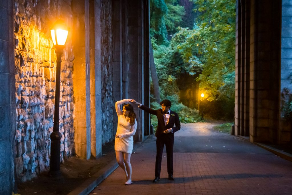 Couple dancing under lamp post in Billings Arcade in Fort Tryon Park