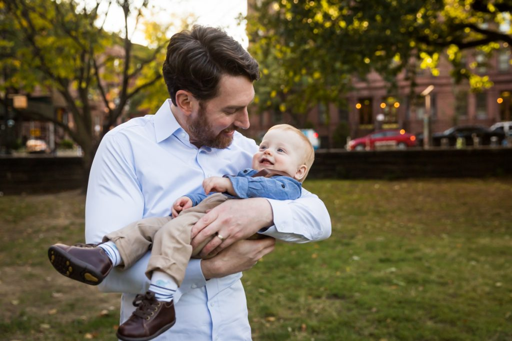 Father holding baby son during a Marcus Garvey Park family portrait session