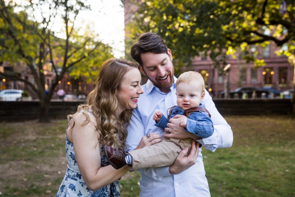 Parents tickling baby son during a Marcus Garvey Park family portrait session