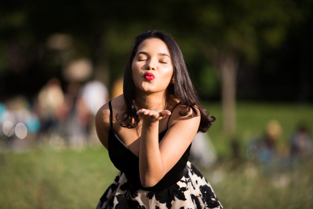 Girl blowing kiss during Gantry Plaza photo shoot